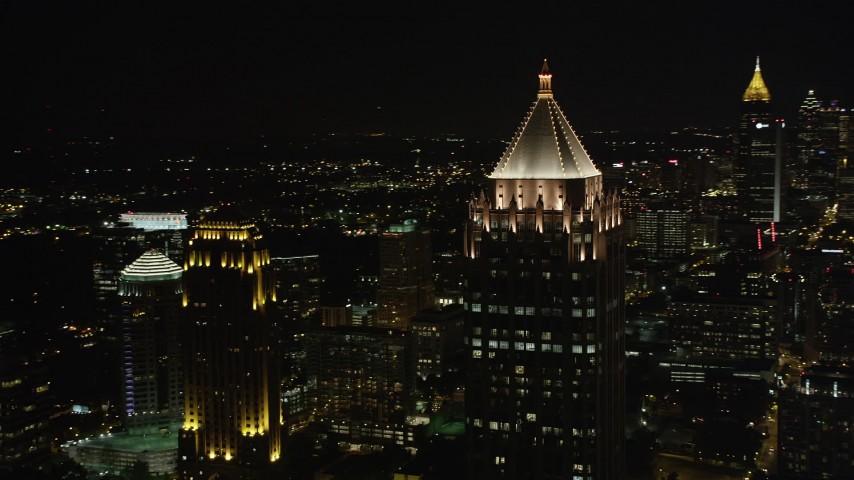 5K stock footage aerial video flying by skyscrapers, Midtown Atlanta, Georgia, night Aerial Stock Footage | AX41_030