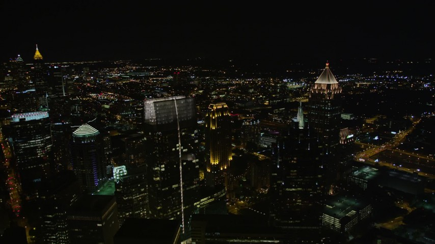 5K stock footage aerial video flying by skyscrapers towering over the city, Midtown Atlanta, Georgia, night Aerial Stock Footage AX41_031 | Axiom Images