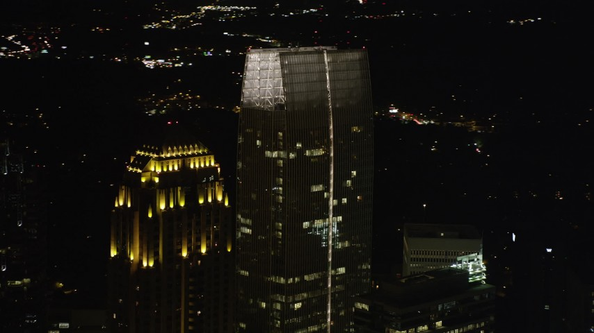 5K stock footage aerial video flying away from 1180 Peachtree revealing GLG Grand, Midtown Atlanta, night Aerial Stock Footage | AX41_033
