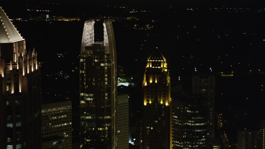 5K aerial video flying by GLG Grand and 1180 Peachtree revealing One Atlantic Center, Midtown Atlanta, night Aerial Stock Footage | AX41_034