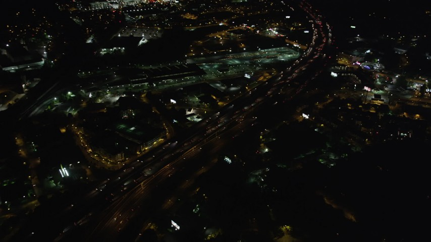 5K stock footage aerial video flying over heavy traffic on an expressway, Buckhead, Georgia, night Aerial Stock Footage | AX41_037