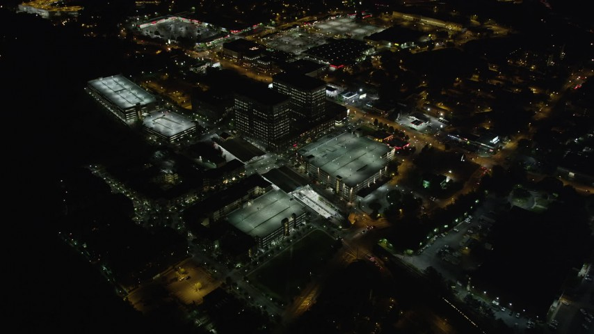 5K stock footage aerial video approaching and tilting down on Lindbergh Center, Buckhead, Georgia, night Aerial Stock Footage | AX41_038