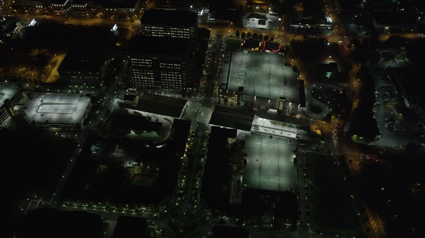 5K stock footage aerial video flying by Lindbergh Center, Buckhead, Georgia, night Aerial Stock Footage | AX41_039