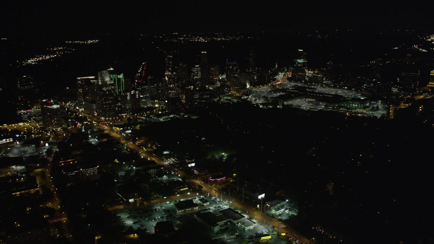 5K stock footage aerial video approaching skyscrapers, Buckhead, Georgia, night Aerial Stock Footage | AX41_041