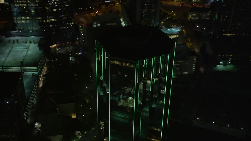 5K stock footage aerial video flying away from 3340 Peachtree Road, Buckhead, Georgia, night Aerial Stock Footage | AX41_048