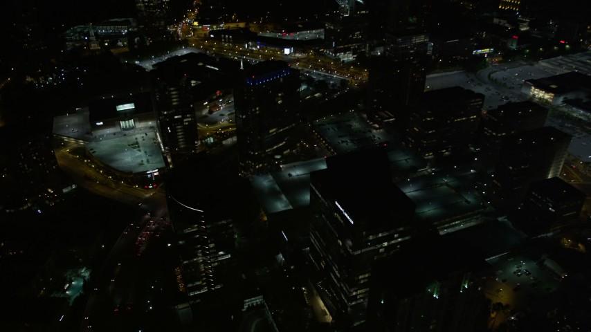 5K stock footage aerial video tilting down on city parking lots, Buckhead, Georgia, night Aerial Stock Footage | AX41_049