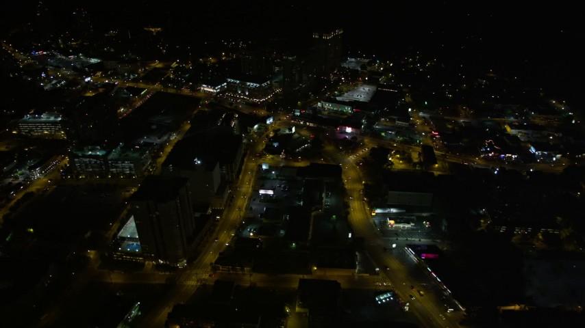 5K stock footage aerial video following city streets revealing city sprawl, Buckhead, Georgia, night Aerial Stock Footage | AX41_052