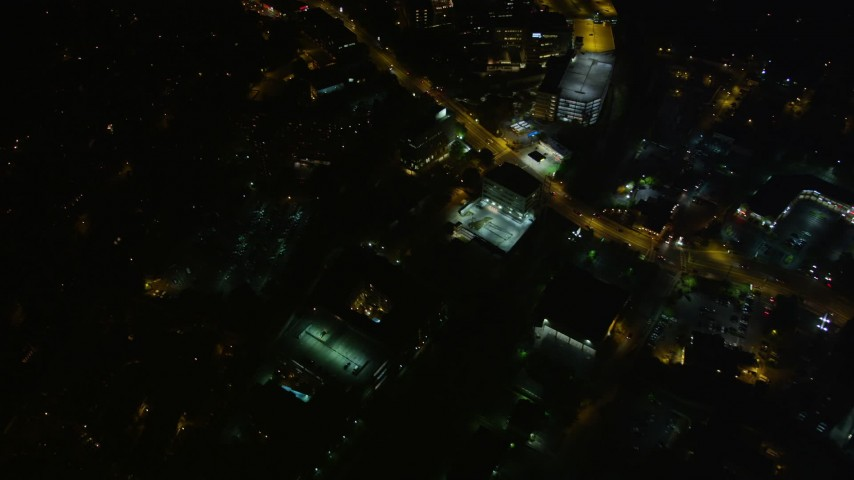 5K stock footage aerial video following a road through the city, Buckhead, Georgia, night Aerial Stock Footage | AX41_053
