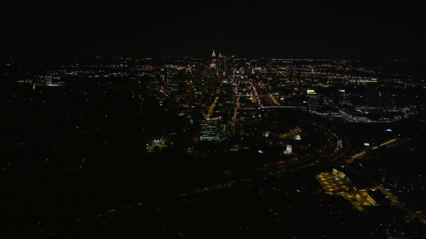 5K aerial video approaching Midtown Atlanta from Buckhead, Georgia, night Aerial Stock Footage | AX41_054