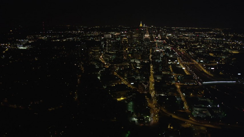 5K aerial video approaching Midtown Atlanta, Georgia, night Aerial Stock Footage | AX41_055