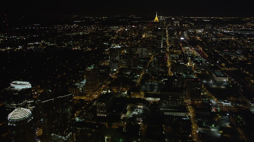 5K stock footage aerial video flying high over the city toward Bank of American Plaza, Midtown Atlanta, night Aerial Stock Footage | AX41_057
