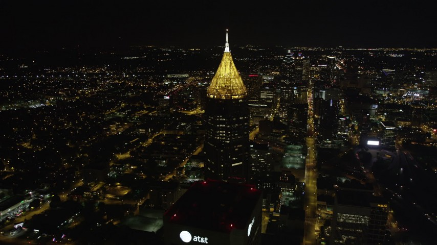 5K stock footage aerial video flying by Bank of American Plaza toward Downtown, Midtown Atlanta, night Aerial Stock Footage | AX41_058
