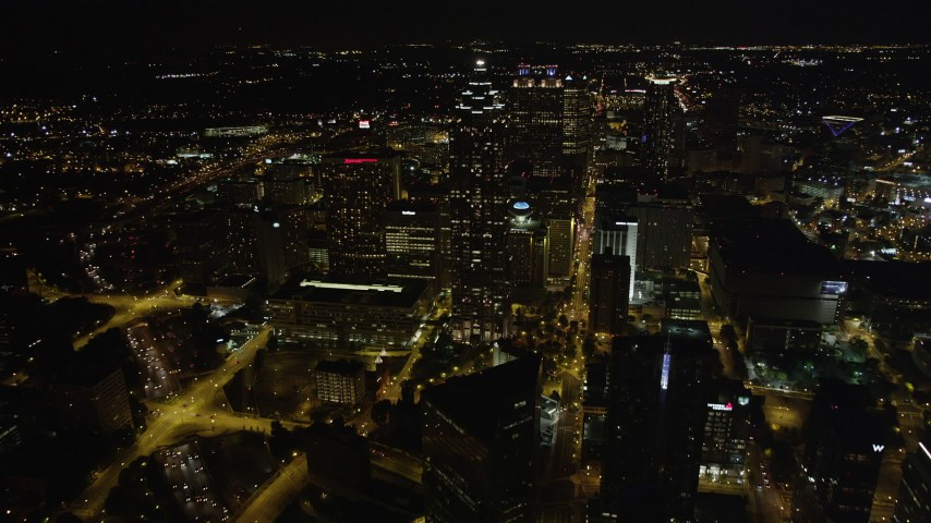 5K aerial video approaching 191 Peachtree Tower and Westin Peachtree Plaza, Downtown Atlanta, night Aerial Stock Footage AX41_059