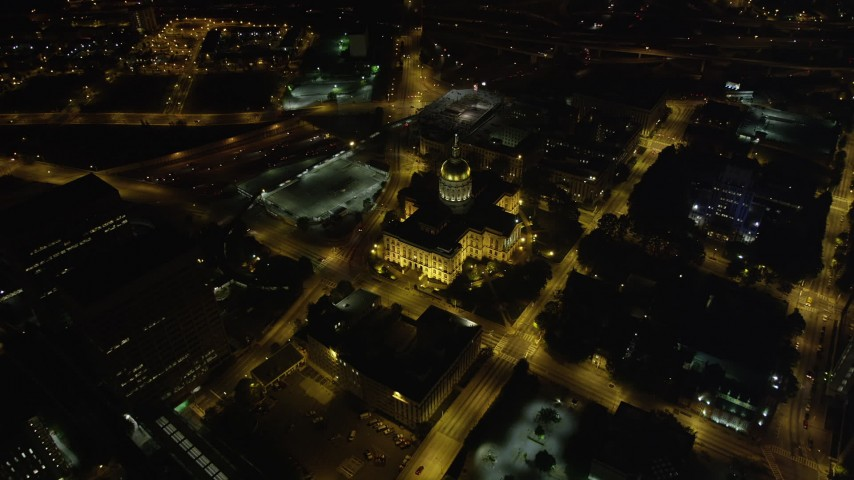 5K stock footage aerial video tilting down to a bird's eye of Georgia State Capitol, Downtown Atlanta, night Aerial Stock Footage | AX41_061