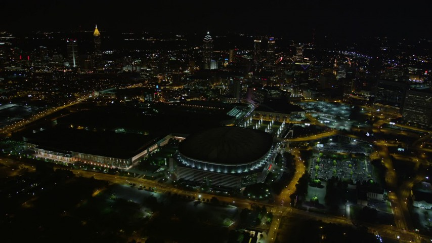 5K stock footage aerial video flying away from Georgia Dome revealing downtown skyline, Atlanta, night Aerial Stock Footage | AX41_064