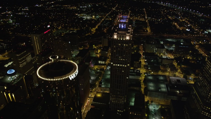5K stock footage aerial video tilting down to bird's eye of skycrapers and city streets, Downtown Atlanta, night Aerial Stock Footage | AX41_066