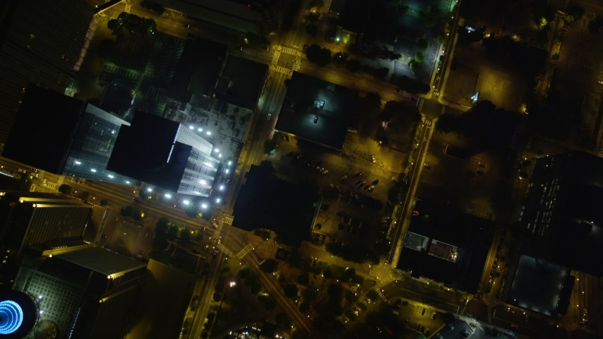 5K aerial video approaching SunTrust Plaza and tilt down to bird's eye of city streets, Downtown Atlanta, night Aerial Stock Footage | AX41_067