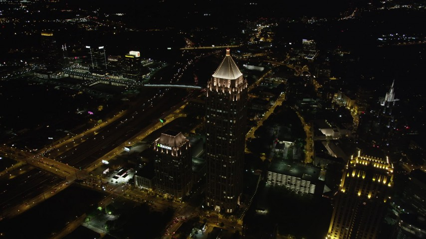 5K aerial video approaching One Atlantic Center, Midtown Atlanta, Georgia, night Aerial Stock Footage | AX41_070