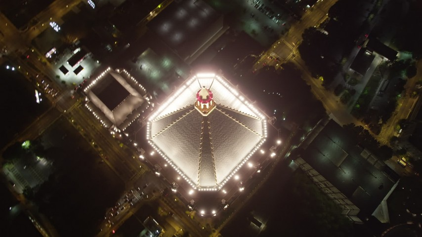 5K stock footage aerial video approaching One Atlantic Center and tilt down on city streets, Midtown Atlanta, night Aerial Stock Footage | AX41_071