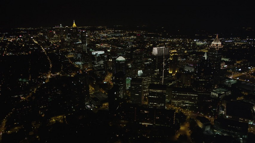 5K stock footage aerial video of skyscrapers and city sprawl, Midtown Atlanta, Georgia, night Aerial Stock Footage | AX41_072