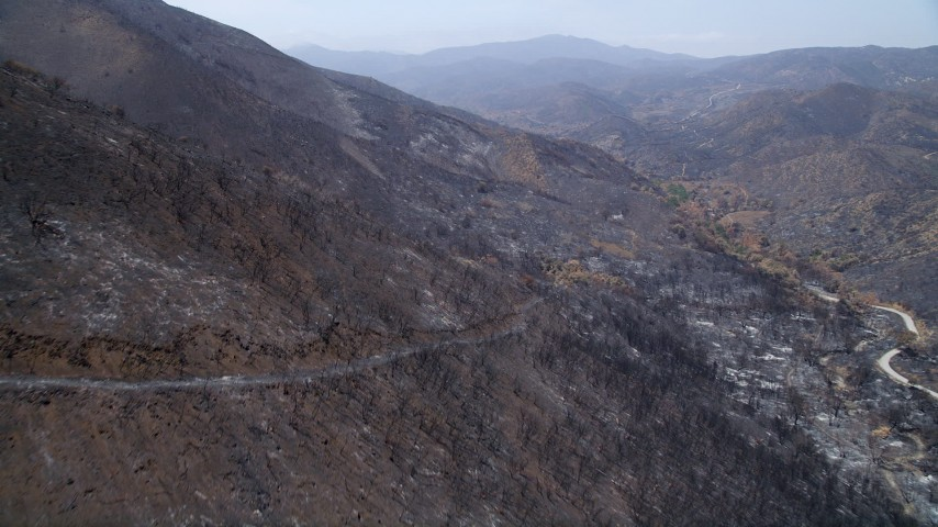 5K stock footage aerial video fly over the wildfire damaged slopes of Santa Monica Mountains, California Aerial Stock Footage | AX42_004