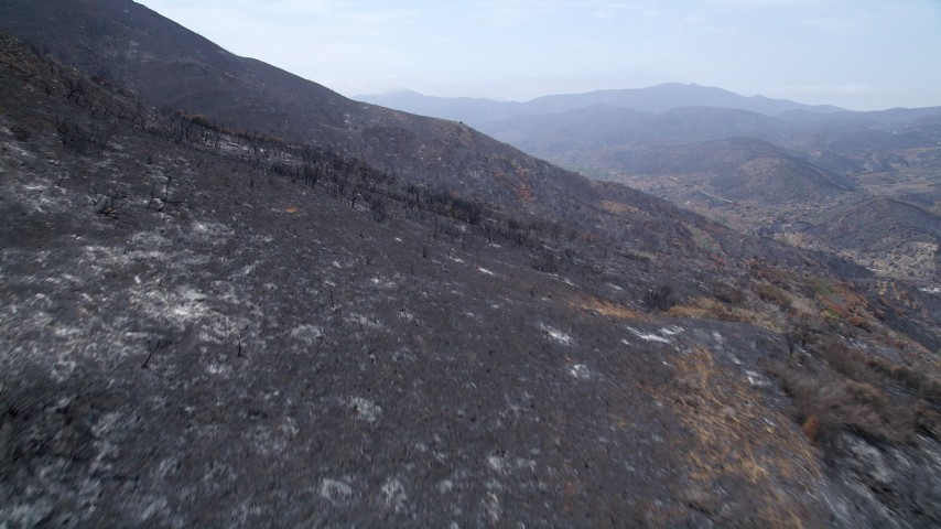 5K stock footage aerial video fly over mountain slopes of Santa Monica Mountains damaged by wildfires, California Aerial Stock Footage | AX42_005