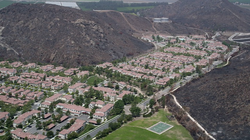 5K stock footage aerial video approach condominiums and duplex homes at the base of hills, Camarillo, California Aerial Stock Footage | AX42_021