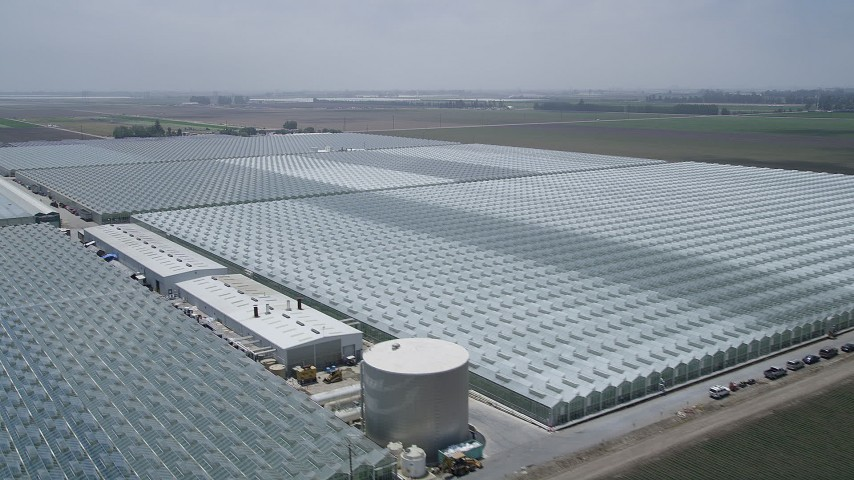 5K stock footage aerial video of flying by large greenhouses, Camarillo, California Aerial Stock Footage | AX42_032