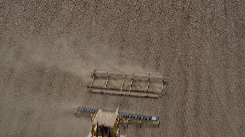 5K stock footage aerial video fly over farm field to approach a tractor tilling a field, Camarillo, California Aerial Stock Footage | AX42_038