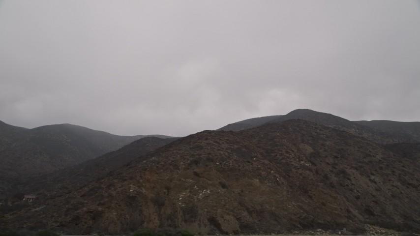 5K aerial video of flying by barren Santa Monica Mountains, Malibu, California Aerial Stock Footage | AX42_063