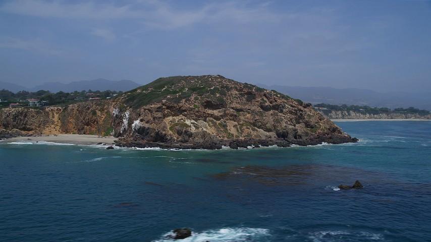 Orbit around the cliffs of Point Dume, Malibu, California Aerial Stock Footage | AX42_088