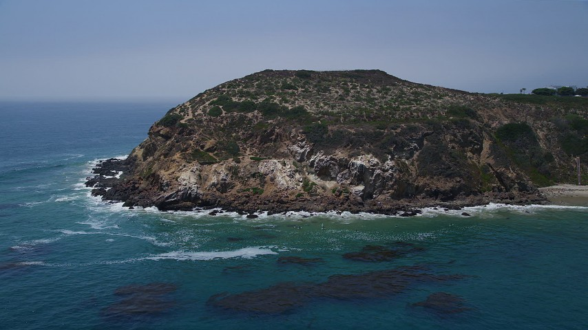 5K stock footage aerial video of blue waters at the bottom of the cliffs of Point Dume, Malibu, California Aerial Stock Footage | AX42_089