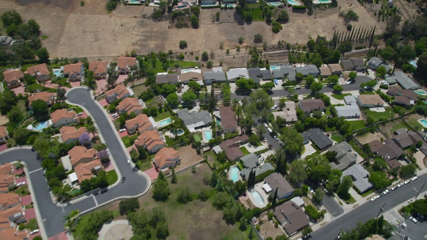 5K aerial video reverse view of tract homes with swimming pools in Calabasas, California Aerial Stock Footage | AX42_118
