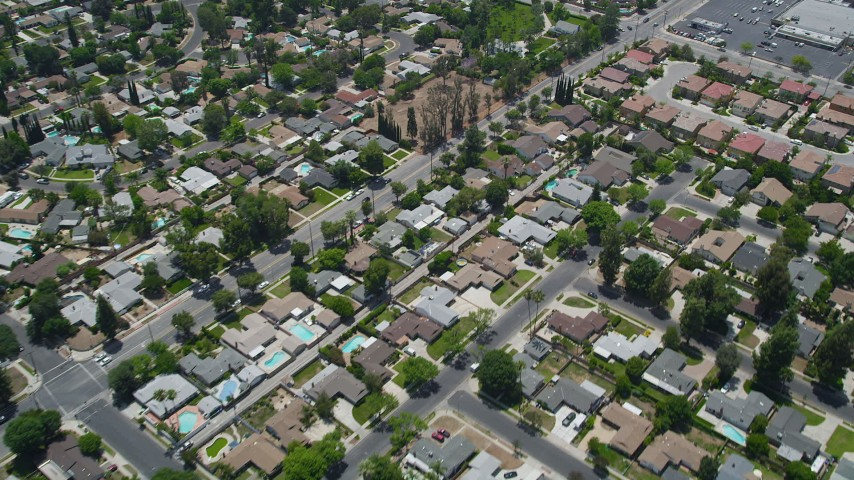 5K stock footage aerial video of a reverse view of suburban residential neighborhoods, West Hills, California Aerial Stock Footage | AX42_119