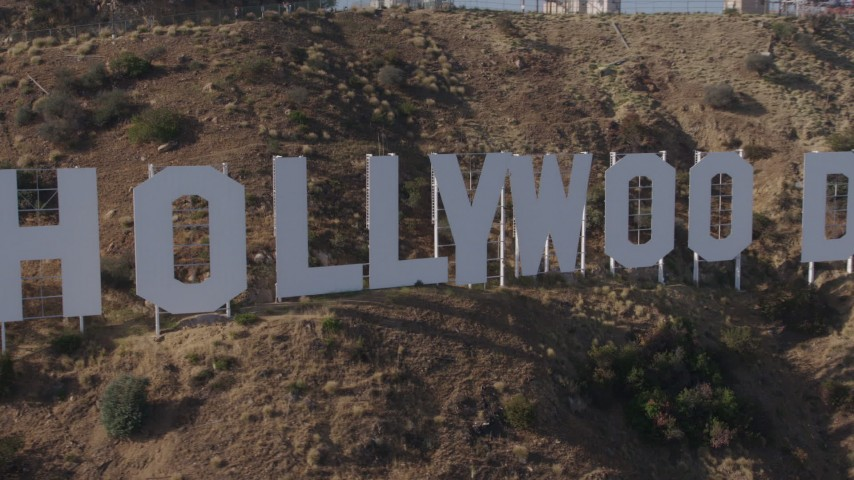 4K stock footage aerial video passing the famous Hollywood Sign, Los Angeles, California Aerial Stock Footage | AX43_003
