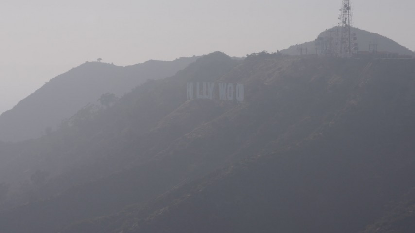 4K stock footage aerial video flying by Hollywood Sign in fog, Los Angeles, California Aerial Stock Footage | AX43_005