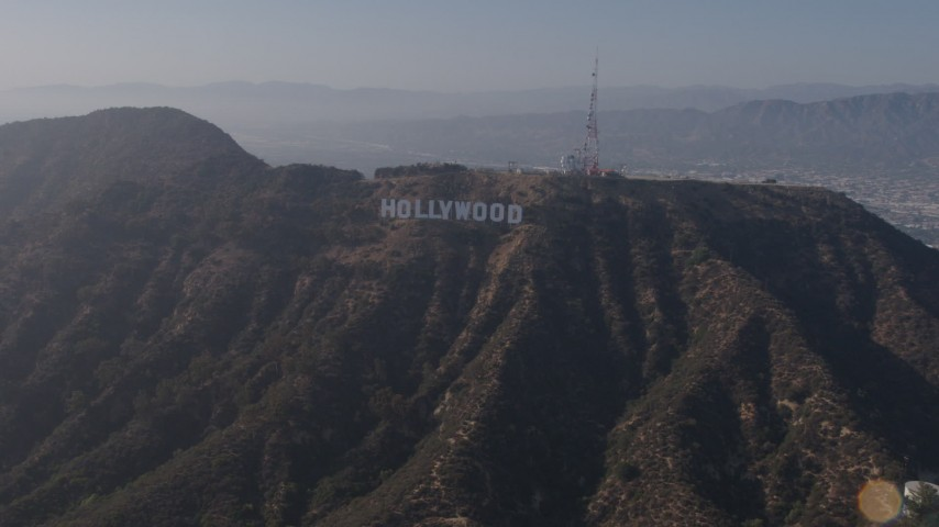 4K stock footage aerial video orbiting the hills to reveal the Hollywood Sign, Los Angeles, California Aerial Stock Footage | AX43_007