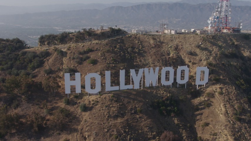 4K stock footage aerial video approaching and flying by the world famous Hollywood Sign, Los Angeles, California Aerial Stock Footage | AX43_009