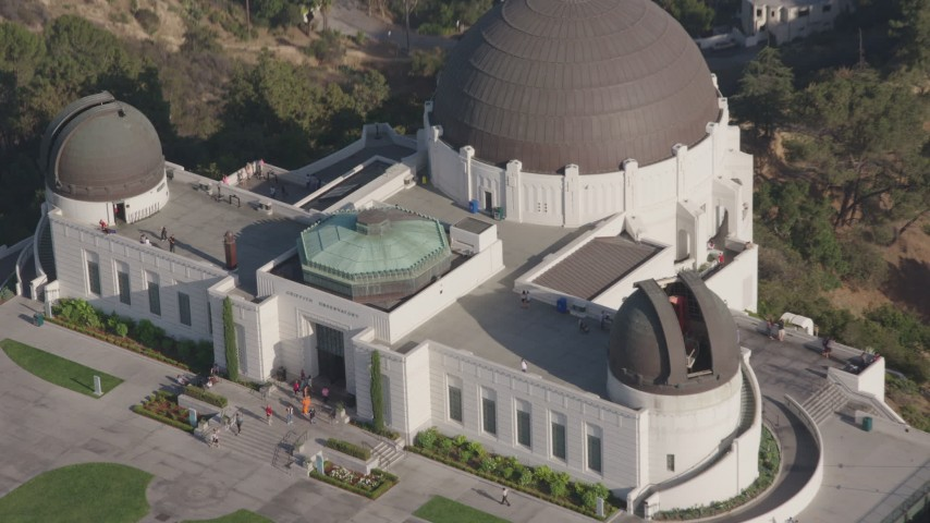 4K stock footage aerial video approaching and tilting down to the north side of Griffith Observatory, Los Angeles, California Aerial Stock Footage | AX43_018