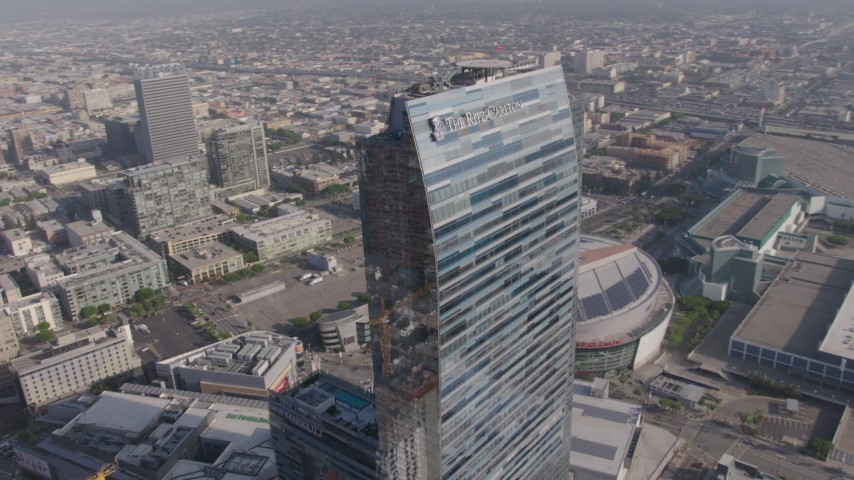 4K aerial video flying by the top of The Ritz-Carlton, Downtown Los Angeles, California Aerial Stock Footage | AX43_020