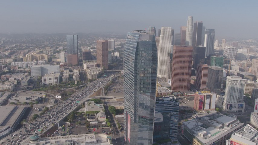 4K stock footage aerial video flying by Ritz-Carlton toward I-110 and Downtown skyscrapers, Los Angeles, California Aerial Stock Footage | AX43_022