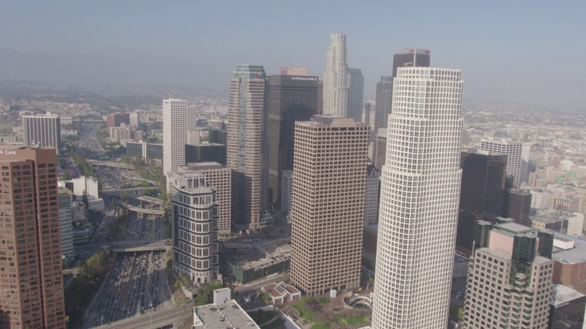 4K aerial video flying by the tall skyscrapers of Downtown Los Angeles, California Aerial Stock Footage | AX43_023