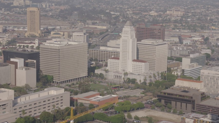 4K stock footage aerial video flying by Bank of America Center to reveal Los Angeles City Hall, Downtown Los Angeles, California Aerial Stock Footage AX43_024 | Axiom Images