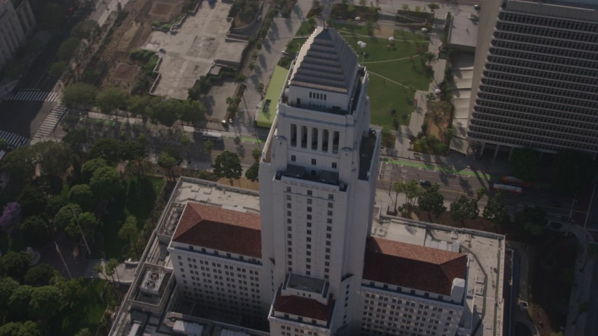 4K stock footage aerial video orbiting the top of Los Angeles City Hall, Downtown Los Angeles. California Aerial Stock Footage | AX43_026