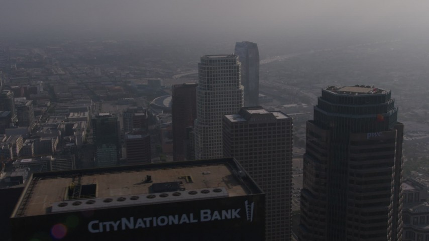 4K stock footage aerial video flying over skyscrapers to reveal heavy traffic on I-110 by The Ritz-Carlton, Downtown Los Angeles Aerial Stock Footage | AX43_028