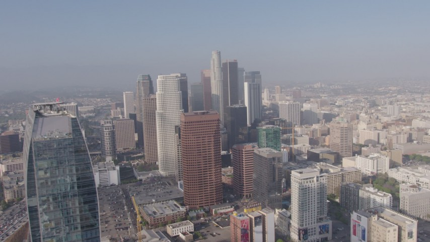 4K aerial video flying by Ritz-Carlton to approach skyscrapers in Downtown Los Angeles, California Aerial Stock Footage | AX43_035