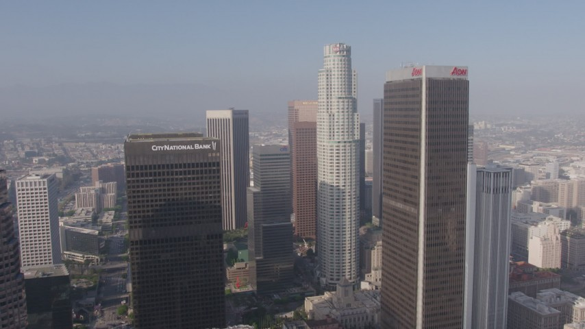 4K stock footage aerial video flying over downtown skyscrapers to approach City National Plaza, US Bank Tower, and Aon Center, Downtown Los Angeles, California Aerial Stock Footage | AX43_036