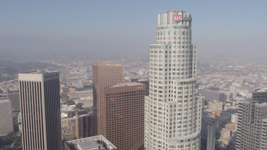 4K stock footage aerial video flying between City National Plaza and Aon Center to approach US Bank Tower, Downtown Los Angeles, California Aerial Stock Footage AX43_037 | Axiom Images
