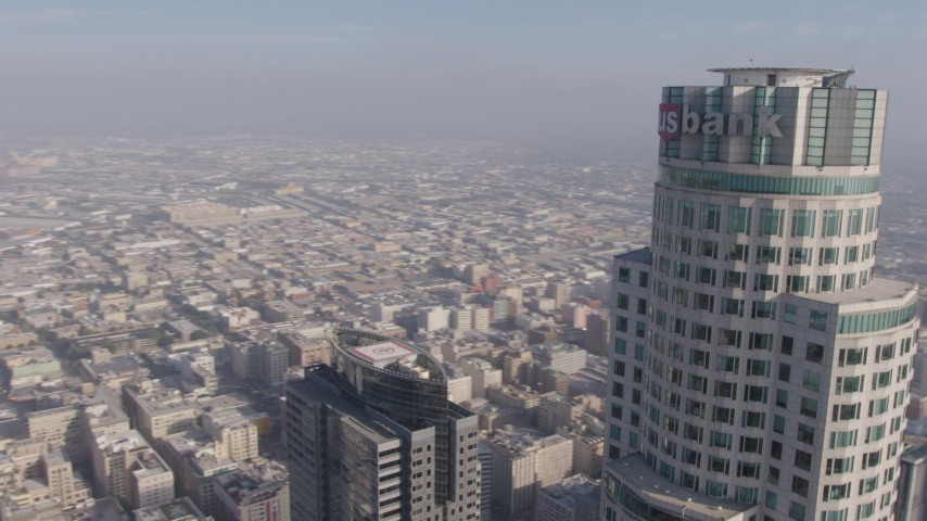 4K stock footage aerial video tracking top of US Bank Tower and fly away from the skyscraper, Downtown Los Angeles, California Aerial Stock Footage | AX43_038