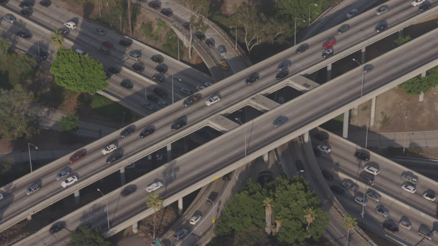 4K stock footage aerial video approaching heavy rush hour traffic on the I-110 / 101 interchange, Downtown Los Angeles, California Aerial Stock Footage | AX43_040